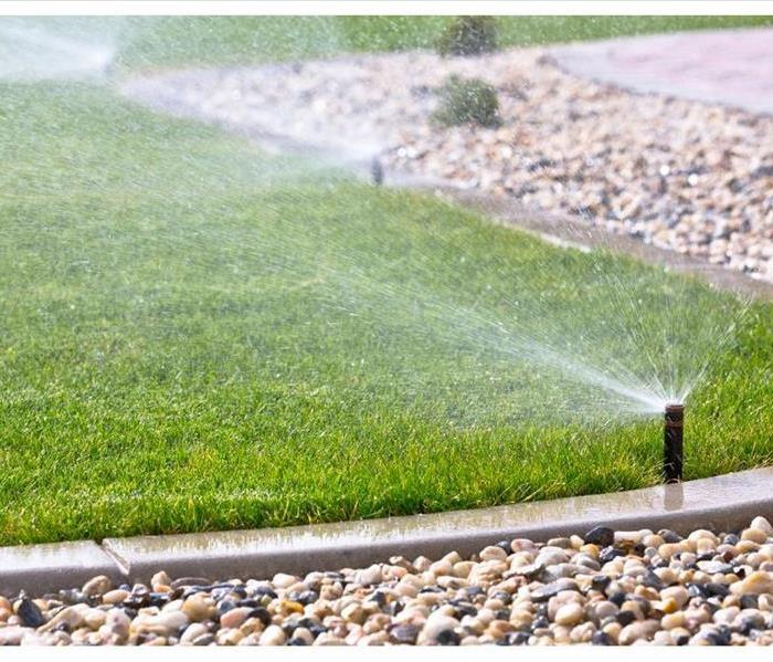 watering lawn with sprinklers